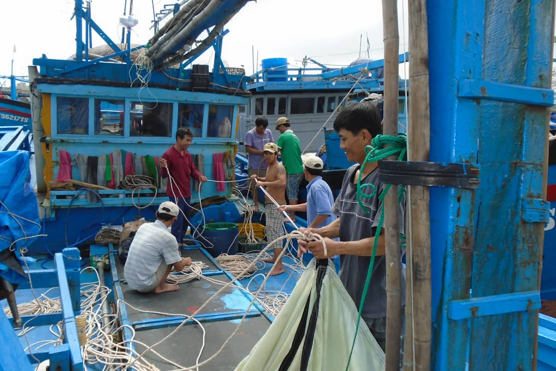 Tuna fisherman in Vietnam aboard a fishing vessel, using longlines and handlines to catch fish.