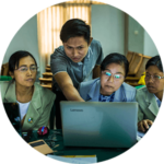 Four participants in a WWF workshop looking at a laptop screen in Naypyidaw, Myanmar
